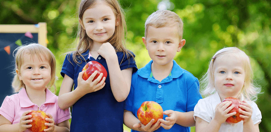 children holding fruits